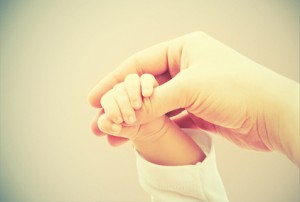 concept of love and family. hands of mother and baby